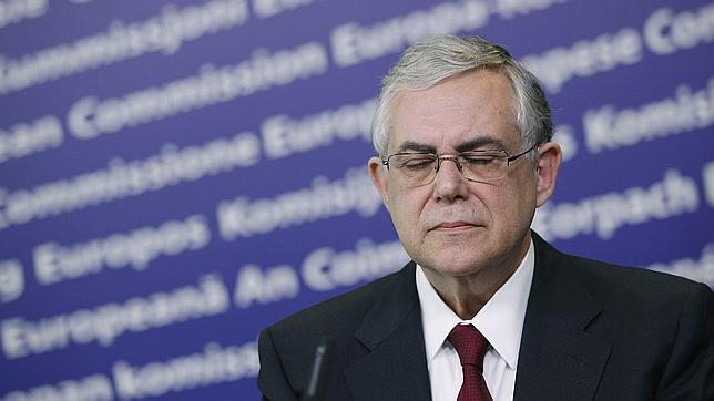 Papadimos se reúne con Juncker y Draghi para tratar los ajustes de Grecia