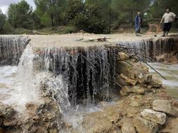 Barranco donde la riada arrastró y mató ayer a las dos mujeres. /EFE