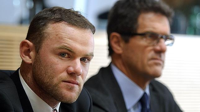 La UEFA rebaja la sanción a Rooney