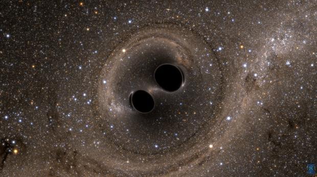Representación de la fusión de dos agujeros negros, estelares, miles de veces menos «pesados» que los supermasivos