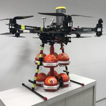 Drone equipped with balls of dry chemical powder