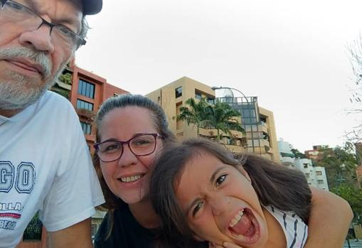 Daniela smiles happily with her parents, before cancer changed their lives