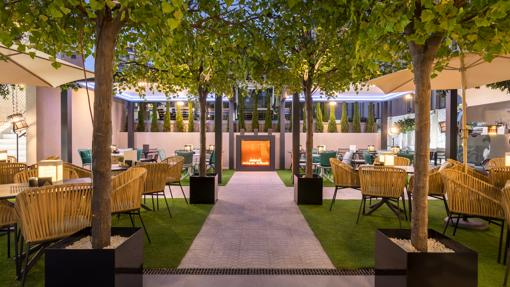 The terrace with fireplace at the Barceló Imagine hotel